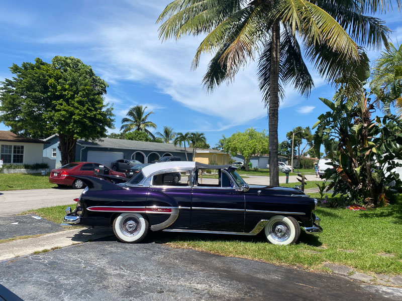 """1953 Chevy Hot Rod Custom Belair """"Stardust"""" in the sun with palm tree"""